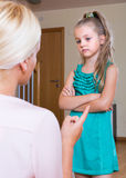 Woman scolding little daughter Stock Image