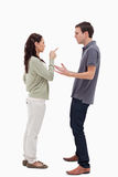 Woman scolding man. Woman scolding men against white background Royalty Free Stock Photography
