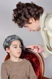 Woman scolding a young boy Stock Photos