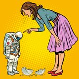 Woman scolds astronaut. The guilty destroyed moon stock photography
