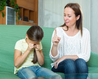 Woman scolds the child Royalty Free Stock Photos