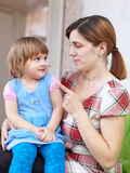 Woman scolds child in home Royalty Free Stock Image