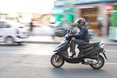 Woman on scooter Royalty Free Stock Images