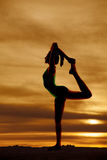 Woman scorpion pose silhouette Stock Photography