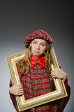 The woman in scottish clothing in art concept Stock Photography