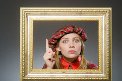 The woman in scottish clothing in art concept Royalty Free Stock Image