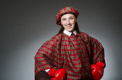 The woman in scottish clothing in boxing concept Royalty Free Stock Photography