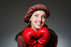 The woman in scottish clothing in boxing concept Stock Images