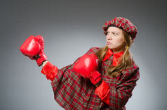 The woman in scottish clothing in boxing concept Stock Photo