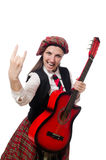 The woman in scottish clothing with guitar Royalty Free Stock Images