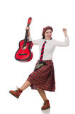 The woman in scottish clothing with guitar Stock Photography