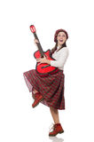 The woman in scottish clothing with guitar Stock Photos