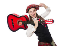The woman in scottish clothing with guitar Royalty Free Stock Photo