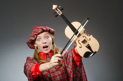 The woman in scottish clothing in musical concept Stock Photo