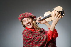 The woman in scottish clothing in musical concept Stock Photos
