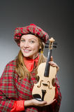 The woman in scottish clothing in musical concept Royalty Free Stock Photo