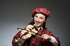 The woman in scottish clothing in musical concept Royalty Free Stock Image