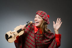The woman in scottish clothing in musical concept Royalty Free Stock Photos