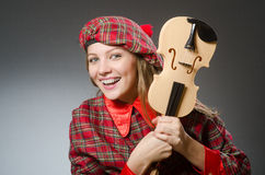 The woman in scottish clothing in musical concept Royalty Free Stock Images