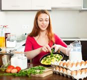 Woman  with  scrambled eggs at home Royalty Free Stock Images