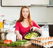 Woman  with  scrambled eggs in pan Royalty Free Stock Photo