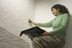 Woman Scrapes Wall - Horizontal Royalty Free Stock Photo