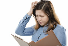 Woman scratching head Stock Images