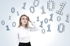 Woman scratching head and ones and zeros Royalty Free Stock Photo
