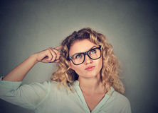 Woman scratching head, thinking daydreaming about something Royalty Free Stock Photography
