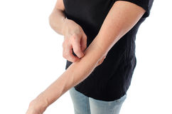 Woman scratching her arm Stock Photos