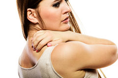 Woman scratching her back isolated Royalty Free Stock Image