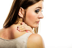 Woman scratching her back isolated Stock Image