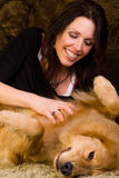 Woman scratching her dogs belly royalty free stock photo