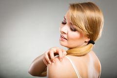 Woman scratching her itchy arm with allergy rash Stock Image