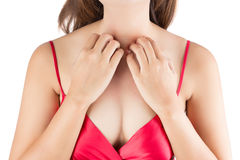 Woman scratching her itchy chest. Isolate on white background stock image
