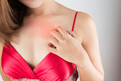 Woman scratching her itchy chest Royalty Free Stock Images