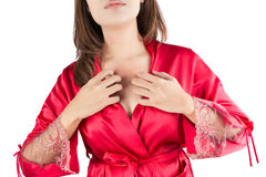 Woman scratching her itchy chest Royalty Free Stock Photo