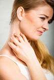 Woman scratching her itchy neck with allergy rash. Health problem, skin diseases. Young woman scratching her itchy neck with allergy rash Stock Photos
