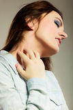 Woman scratching her neck Royalty Free Stock Photo