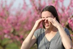 Free Woman Scratching Itchy Eyes In Spring In A Flowers Field Stock Images - 214086764