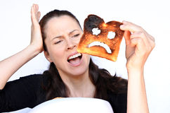 Woman scream at a burnt slice of toast Royalty Free Stock Images