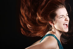 Woman screaming. A beautiful young woman wither her fiery hair in motion screaming Stock Photo