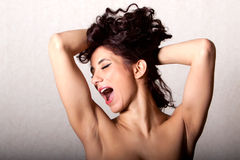 Woman screaming. Sexy woman with long dark hair screaming Royalty Free Stock Image