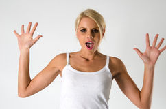 Woman screaming. Amazed woman holding arms up in surprise Stock Photos