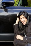 Woman screaming angry of scratched car stock photo