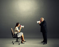 Woman screaming at angry senior man Stock Images