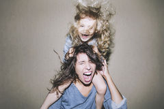 Woman is screaming and arguing with a child on his shoulders cli Royalty Free Stock Photography