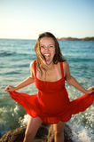 Woman screaming on the beach Stock Images