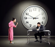 Woman screaming at busy man Stock Images