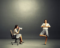Woman screaming at calm woman over dark Stock Photography